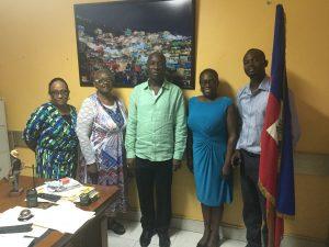 Dr. Helen Newton, Mayor Dominic St. Roc, Pastor Jessie White, Pasteur Reynold St. Cine, and Mrs. Jacquie Kowalsky